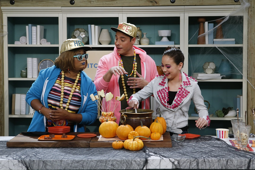 Guest Amber Kelley demonstrates her Leftover Candy Fondue idea with hosts Sunny Anderson and Jeff Mauro as seen on Food Network's The Kitchen, Season 11.